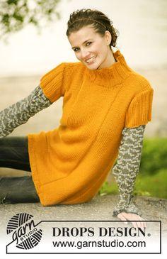 DROPS løst strikket kjole i Alaska med korte eller lange ærmer Gratis opskrifter fra DROPS Design.