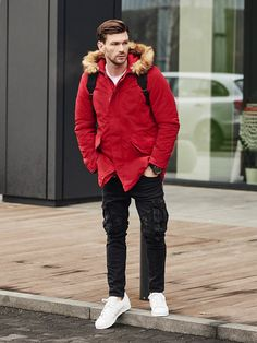 Joggers with cargo pockets, a printed long sleeve top and a sport watch are all time casual classics. This look from the Bolf collection has to stand out. The red parka jacket with a detachable hood makes a really good impression.