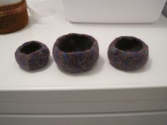 3 little bowls with purple, orange, blue and I don't know what else as far as color is concerned.