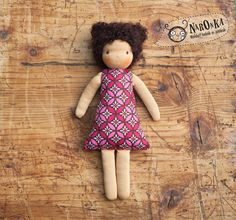Waldorf inspired retro style textile doll with curly brown hair.