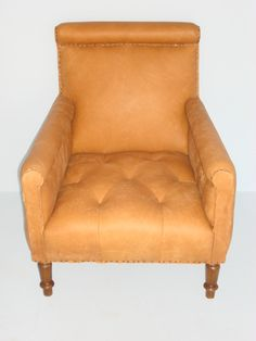Discontinued Item Limited Stock Available 2 in Dallas  Sun Valley Library Chair in Leather Upholstered in Caramel Leather (grade 500) with Nail Tack Detail Tufted Seat with Extended Arm