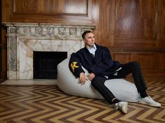 Raf Simons, pictured here with one of his latest designs for Kvadrat.