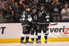 Dustin Brown #23, Justin Williams #14 and Anze Kopitar #11
