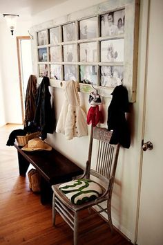 Old door, painted & hung on wall to display photos & hold coats! Awesome idea!