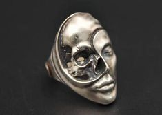 Cool handle human and skull ring