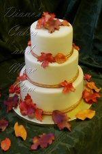 Delicious fall wedding cake with leaf motif.