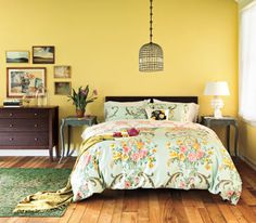 Gold on the walls. The key to this is a light colored ceiling and bedding. Cozy yellow country getaway bedroom