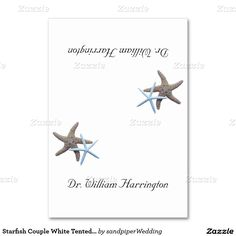 Simple white, tropical tented place cards with starfish and name template on both sides.