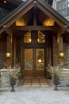 Inspiring Flip Flop Door Mat for Your Luxury Home: Wonderful Of Rustic Entry With Flip Flop Door Mat And Front Porch Also Plate Glass Plus Potted Plants And Stone House With Wood Beams For Luxury Living ~ mynines.com Door Inspiration