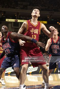 Yao Ming #13 of the China Basketball Men's Championship Team boxes out Ben Wallace #13 of the USA Men's World Championship Team at The Arena in Oakland, California.