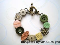 Assemblage bracelet with upcycled watch parts, my hand-stamped polymer clay tiles in green, salmon and ivory, and assorted doodads.