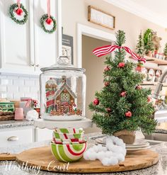 Christmas kitchen island vignette featuring a Christmas village house in a glass canister || Worthing Court