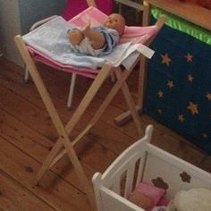 Make a dolls change table out of an old laundry hamper