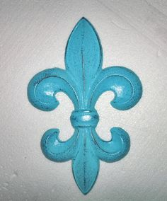 Aqua Blue Wall Decor / Fleur de Lis / French Country / Cast Iron Decor / Paris apartment/ Kitchen decor. $21.00, via Etsy.