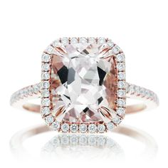 With its classic design and sparkling diamonds, this engagement ring is a beautiful combination with the center Morganite. Well-crafted in precious 14K rose gold, the eye is drawn to the peachy pink 10x8 morganite center stone. A halo frame of shimmering accent diamonds wraps this gemstone in a spar