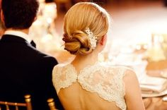 gorgeous, simple wedding updo with flowers, via Breakfast At Barneys