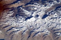 Earth's Highest Mountain Photographed From Space | Perspective Credit: Malenchenko/Russian Federal Space AgencyThe world's highest mountain doesn't look quite so high from space.    Russian cosmonaut Yuri Malenchenko recently snapped a shot of Mount Everest from his perch 230 miles (370 kilometers) above Earth on the International Space Station. The photo shows the peak of Everest nestled among other crags in the Himalayas, with snow lightly dusting the tops.