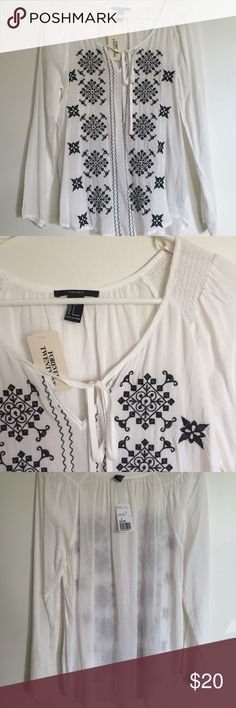 NWT Embroidered Long Sleeved Top NWT never worn Forever 21 long sleeved white top with black embroidery details • size small • would look so cute with jeans and boots Forever 21 Tops Blouses