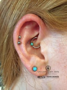 We have had the privilege of piercing Phoebe for several years now, so doing this daith piercing was truly a delight. She went with an anatometal 16g captive bead ring made from implant grade steel and a lovely turquoise accent that ties in wonderfully with her other piercings. Thank you, Phoebe! vaughnbodyartsMonterey, CA