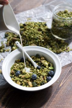 Matcha granola with dried blueberries. All of the goodness of matcha powder tossed with a delish granola. Perfect snack or breakfast--tons of antioxidants! Vegan