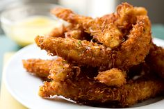 Crunchy Coconut Chicken Strips OMG just made this! So delicious!! The honey mango sauce is AMAZING!
