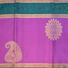 TRENDY LONG BORDER WITH EMBOSSED DESIGN : Small embossed floral motives adorn the body of this pure zari Kanchipuram silk saree. The pink long border is hand-woven with paisley and chakra zari motives.