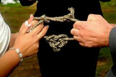 "Tying the fishermans ""love"" knot Fall outdoor Northwoods themed wedding"