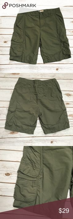 """REI Olive green nylon Hiking Camping Shorts REI Olive green hiking/camping nylon Shorts. Pockets on front and back. Adjustable waistband for a tighter fit. Size Women's 8. No damage.  Waist 15.2"""" Rise 10.2"""" Inseam 9.5"""" REI Shorts Cargos"""