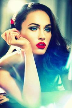 Megan Fox looks sexy and sophisticated. Get the look with a red lip and sultry eyes.