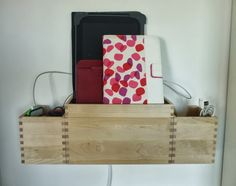 IKEA Hackers: Wall-mounted charging station plus earphone/cable storage #DIY