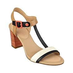 39.95 Feather Sandal Watch heads turn as you sail by in this Tommy Hilfiger Feather sandal! Absolutely chic in a colorblocked leather upper and stacked heel, these city sandals are sophisticated, refined, and adorable!