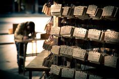 Shinto worshippers write their prayers or wishes on that Ema plaques, hang it on the left side at the shrine, where the kami receive them.
