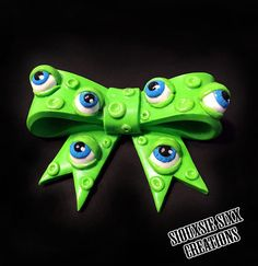 Zombie Eyeballs Bow made of polymer clay. Choose between Brooch or Pendant