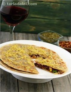 Using flour tortillas as a base, top with beans, corn and cheese and then grill to make this tasty pizza.