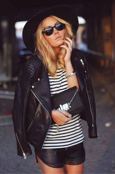 leather jacket, striped tee, and leather shorts...add some red bottoms and you have it all right ;)