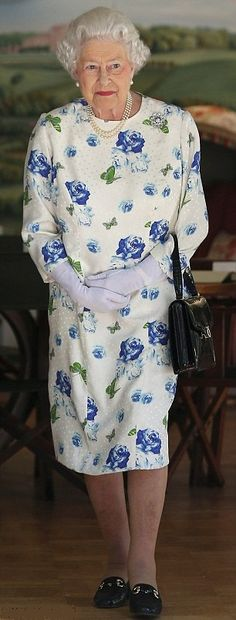 Her Majesty Queen Elizabeth II leaves the Summer House in the grounds of Buckingham Palace on the first day of the Coronation Festival on 11 July 2013 in London, England.