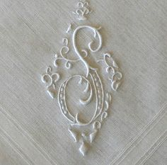 White work S initial. Great article about antiques hankies with beautiful examples.