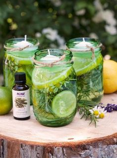 Mason jar floating candles in citronella oil with herbs. Perfect for backyard parties, gatherings and outdoor weddings. Homemade Candles, Diy Candles, Outdoor Candles, Floating Candles, Outdoor Dining, Candle Centerpieces, Diy Organic Candles, How To Make Scented Candles At Home, Simple Centerpieces