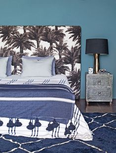 A master bedroom is an oasis in blue tones.
