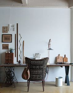Table legs, one side is an old sewing machine table...love the rulers on the wall.