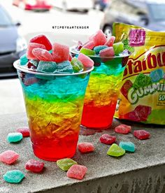 Rainbow Sour Burst Cocktail - For more delicious recipes and drinks, visit us here: www.tipsybartende...