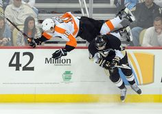 APRIL 13, 2012: Penguins winger James Neal upends the Flyers' Brayden Schenn during the second period on Friday, April 13, 2012, at Consol Energy Center.  Christopher Horner   Tribune-Review