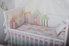 Like the houes cushions surrounding the crib for girl room
