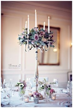 Our candelabra look stunning dressed with flowers and make an elegant tall table centrepiece. Captured by Teresa C Photography