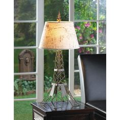 Parisian Table Lamp. The metal wire frame mimics Paris' most famous landmark, the Eiffel Tower, fashioned in industrial-inspired metal with a vintage patina. The travel-stamped shade and French flourish on top make this lamp a continental charmer. #tablelamp #freeshipping