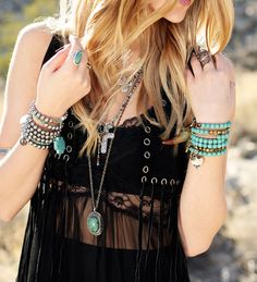 Fringed top and turquoise jewels.