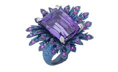 "Stunning Jewelery Collection ""The Seven Deadly Sins"" by Stephen Webster. PRIDE – The proud peacock ruffles its royal feathers. Blue Titanium Ring, set with White Diamonds, Pink Sapphires and Amethyst."
