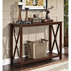 Let the long, elegant lines of this espresso sofa table add style to your room. The delicate X-design sides and long, useful shelves make this light and airy piece both beautiful and practical. The glossy wooden finish is easy to maintain.