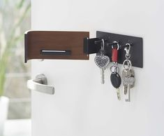 Stylish wooden key rack with 3 hooks. Choose from a dark or light wood finish.