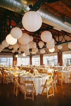 Decorate your venue with multiple styles of paper lantern, like this wedding found on bridesofnorthtexas.com